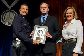 Tait's Steve Cragg with Charlie Beck, Chief of the LAPD, and Cecilia Aguilera Glassman, Executive Director of the LAPD Foundation.