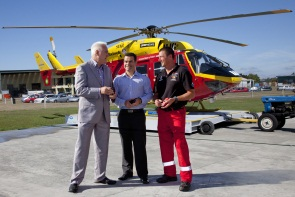 Rick Knight, Advanced Rescue Paramedic (right), with Ian McKee, Tait General Manager (left), and Tony Davis, Product Business Manager, in front of the Westpac Rescue Helicopter.