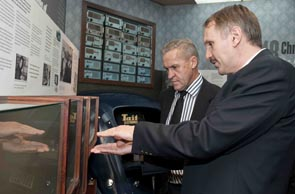 Tait Managing Director Frank Owen (closest) shows Acting Minister for Economic Development David Carter through the Tait Museum.